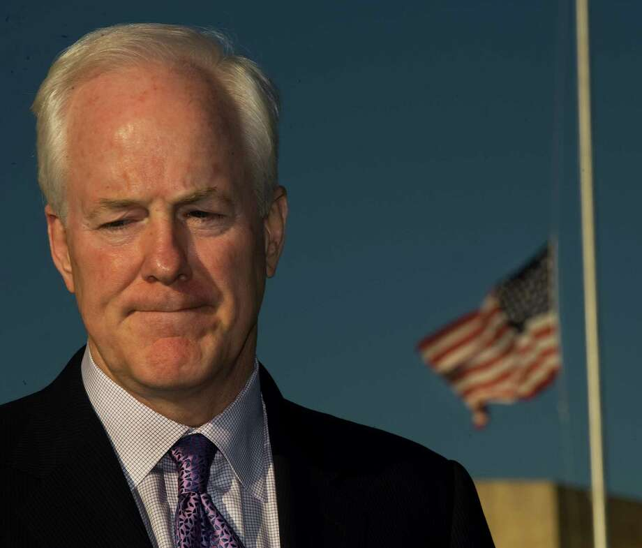 The US flag flies at half-staff as Senator John Cornyn delivers remarks on Nov. 6, 2009 outside US Army III Corps Headquarters one day after the shootings at Fort Hood in Texas. Photo: PAUL J. RICHARDS, AFP/Getty Images / AFP