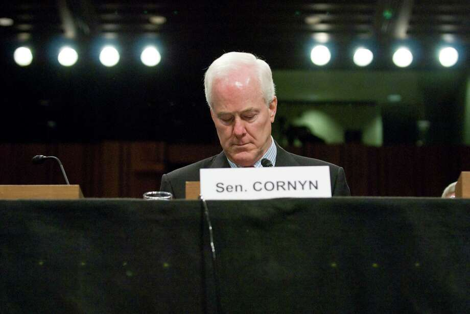 Sen. John Cornyn takes his seat for a hearing on the incidence and prevention of military suicides by the Personnel Subcommittee of the Senate Armed Services Committee in Washington on March 18, 2009. Photo: Jonathan Ernst, For The Chronicle / Freelance