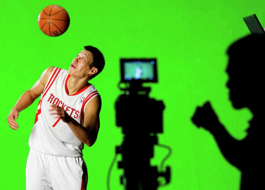 Houston Rockets guard Jeremy Lin flips a ball in the air while filming a video promo during Rockets Media Day Monday, Oct. 1, 2012, in Houston. Photo: Brett Coomer, Chronicle / © 2012 Houston Chronicle