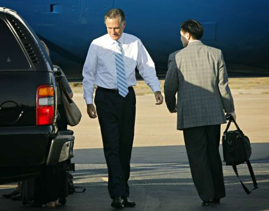 Republican presidential candidate and former Massachusetts Gov. Mitt Romney prepares to depart Dallas Love Field Wednesday, Sept. 19, 2012 following a fundraising stop in Dallas the day before.   (G.J. McCarthy / Associated Press)