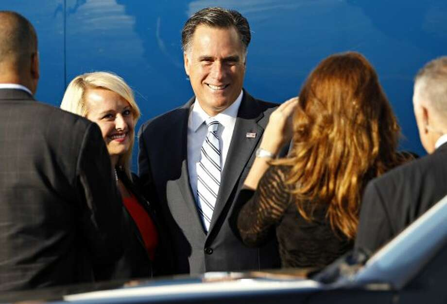 Republican presidential candidate and former Massachusetts Gov. Mitt Romney poses for pictures with supporters, before boarding his campaign charter plane at Love Field in Dallas, Wednesday, Sept. 19, 2012.  (G.J. McCarthy / Associated Press)