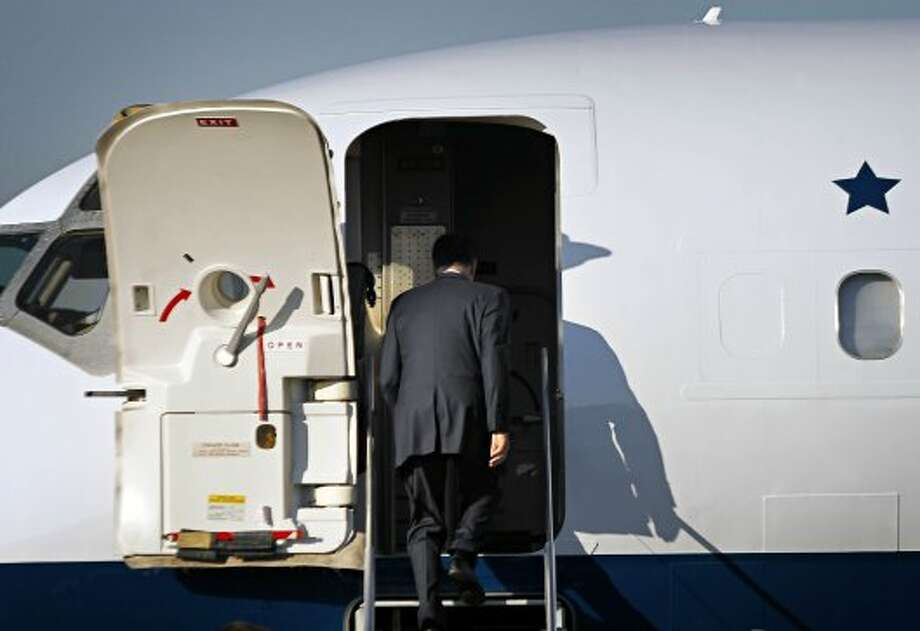 Republican presidential candidate and former Massachusetts Gov. Mitt Romney boards his campaign charter plane at Love Field in Dallas, Wednesday, Sept. 19, 2012.  (G.J. McCarthy / Associated Press)
