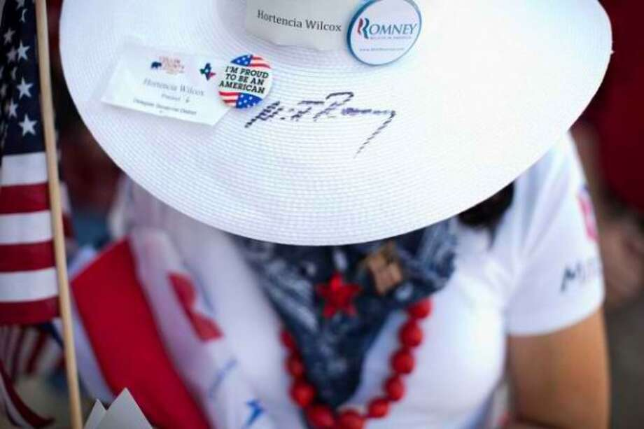 Hortensia Wilcox of Allen has a special souvenir -- a hat autographed by the candidate himself, Mitt Romney. (AP)