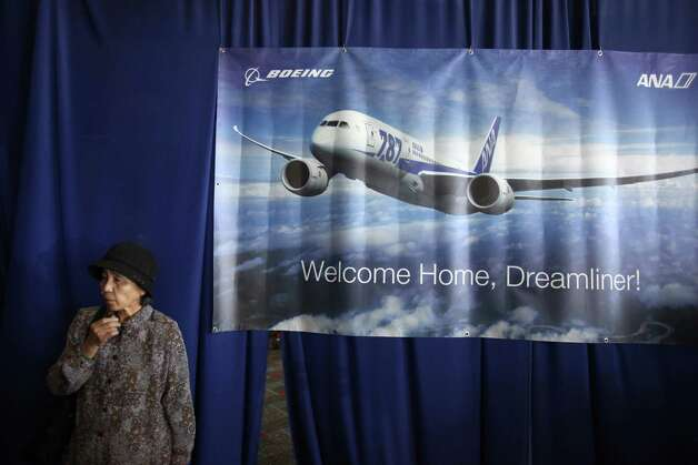 Passenger Toshiko Nakamura waits to board first Boeing 787 to provide commercial service to Sea-Tac  Airport. Photo: JOSHUA TRUJILLO / SEATTLEPI.COM