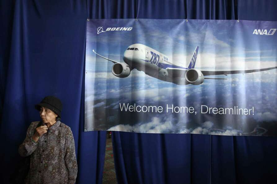 Passenger Toshiko Nakamura waits to board first Boeing 787 to provide commercial service to Sea-Tac&