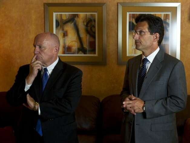Kevin Brady, R-Texas, and Eric Cantor answer questions during a fundraising event Friday, Aug. 12, 2011, in The Woodlands. (Cody Duty / Houston Chronicle)