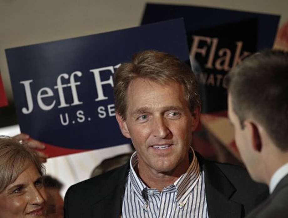 Arizona Republican Senate candidate and current U.S. Rep. Jeff Flake, R-Ariz., speaks at a primary election night party, Tuesday, Aug. 28, 2012, at his home in Mesa, Ariz. Early polling humbers have Flake ahead of his challenger, Wil Cardon,in his effort to fill retiring Sen. Jon Kyl's, R-Ariz, seat.  (Matt York / Associated Press)