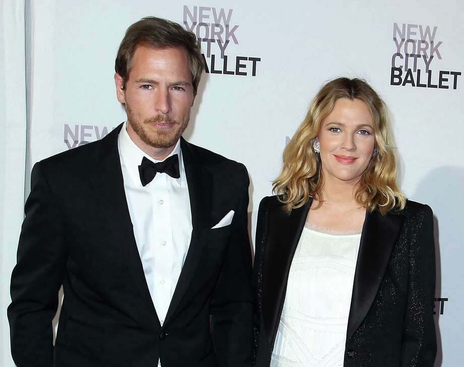 "FILE - This May 10, 2012 file photo shows Will Kopelman, left, and Drew Barrymore attending the New York City Ballet's 2012 Spring Gala performance in New York. The couple welcomed a baby girl named Olive Barrymore Kopelman on Sept. 26. A statement from Chris Miller at Barrymore's production company Flower Films said the baby was born ""happy, healthy and welcomed by the whole family."" It did not provide specifics on the birth. (AP Photo/Starpix, Amanda Schwab, file) Photo: Amanda Schwab"