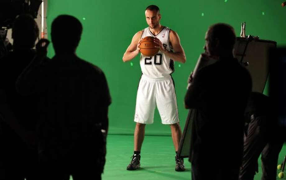 The San Antonio Spurs Manu Ginobili poses for a video shot during media day at the team's practice facility.  Oct. 1, 2012. (San Antonio Express-News)