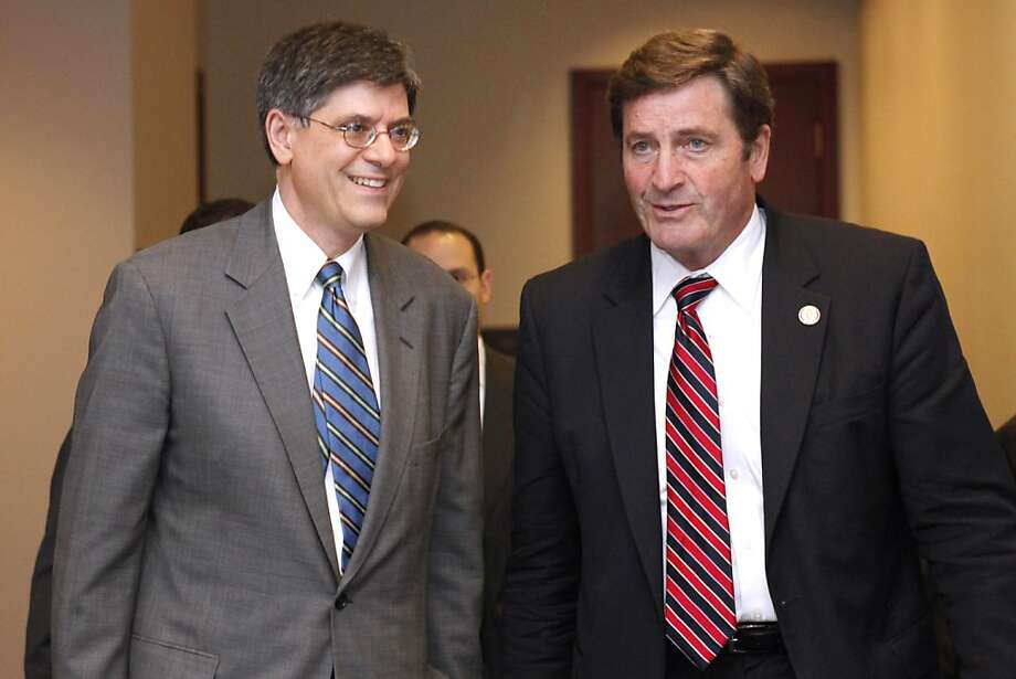 Budget Director Jacob Lew, left, exits a Democratic caucus meeting with Rep. John Garamendi, D-Calif., Wednesday, Sept. 21, 2011, on Capitol Hill in Washington. Photo: Jacquelyn Martin, AP