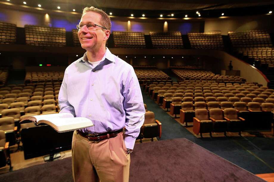 Houston's First Baptist Church pastor Gregg Matte stands in the sanctuary of his church holding the fairly new Holman Christian Standard Bible on Thursday, Jan. 26, 2012, in Houston.  Matte announced this month that he will no longer be preaching from the New International Version (NIV) of the Bible, because the updated version has raised accuracy concerns, they will instead use the Holman Christian Standard Bible. ( Karen Warren / Houston Chronicle ) Photo: Karen Warren / © 2012  Houston Chronicle