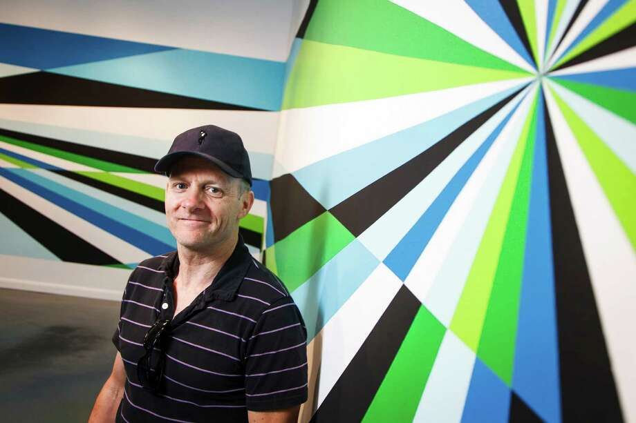 "Aaron Parazette stands in front of his 7-by-56-foot acrylic wall painting ""Flyaway,"" the ""wow"" feature of his exhibit at Art League Houston, where he's being celebrated as Texas Artist of the Year. Photo: Michael Paulsen / © 2012 Houston Chronicle"