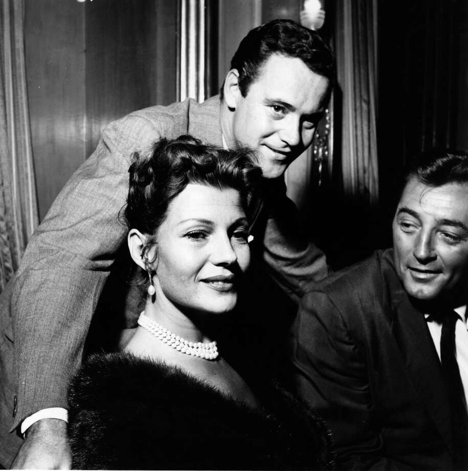 1958: Co-host Jack Lemmon, who played host at the event four times in his career. Pictured above at center with Rita Hayworth and Robert Mitchum. Photo: Mitchell, Getty Images / Hulton Archive
