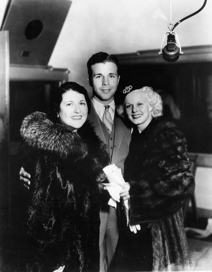 1948: Co-host Dick Powell, pictured with Louella Parsons, left, and actress Jean Harlow. Photo: Hulton Archive, Getty Images / Hulton Archive