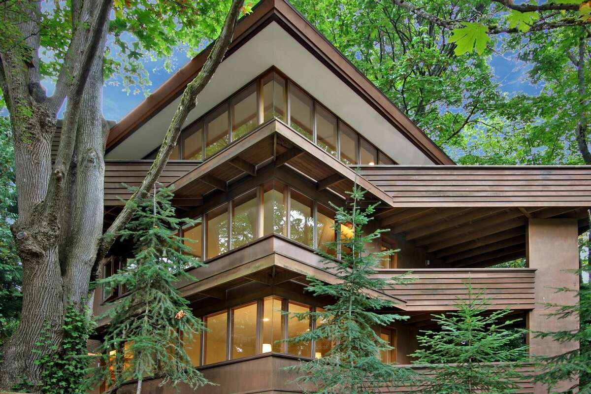 Here's your chance to live in the home a noted Seattle contemporary architect designed for himself. Milton Stricker apprenticed with Frank Lloyd Wright and opened his own office in 1962, focusing on
