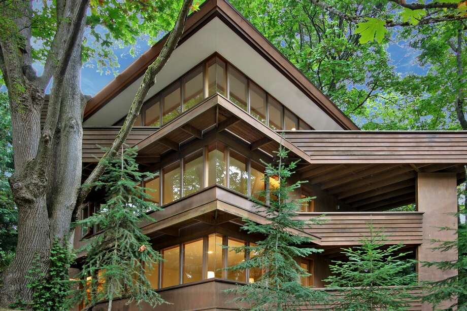 "Here's your chance to live in the home a noted Seattle contemporary architect designed for himself. Milton Stricker apprenticed with Frank Lloyd Wright and opened his own office in 1962, focusing on ""organic"" design. His work includes the Clark Turner House, on Vashon Island, Peace Lutheran Church, in Bremerton, Seattle Fire Station No. 24, and the Paul Johnston House, in Seattle. This house, 3211 S. Massachusetts St., was built in 1991. The 2,340-square-foot house has three bedrooms, 3.5 bathrooms, wood walls, built-in cabinets vaulted ceilings, stained glass, and multiple decks on a 5,160-square-foot lot. It's listed for $715,000. Photo: Courtesy Cliff Tanner/Windermere Real Estate"