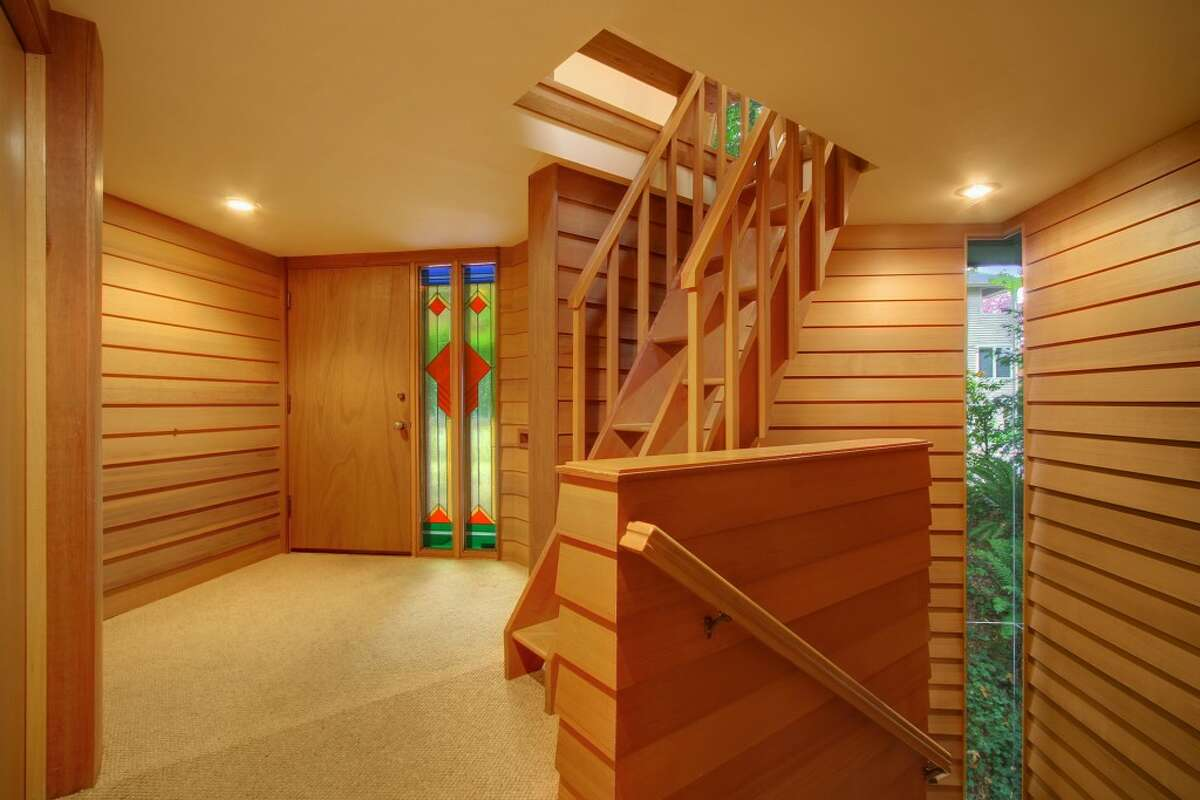 Entry of 3211 S. Massachusetts St. The 2,340-square-foot Milton Stricker-designed house, built in 1991, has three bedrooms, 3.5 bathrooms, wood walls, built-in cabinets vaulted ceilings, stained glass, and multiple decks on a 5,160-square-foot lot. It's listed for $715,000.