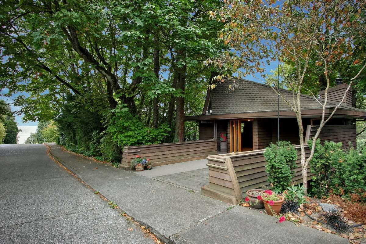 Front of 3211 S. Massachusetts St. The 2,340-square-foot Milton Stricker-designed house, built in 1991, has three bedrooms, 3.5 bathrooms, wood walls, built-in cabinets vaulted ceilings, stained glass, and multiple decks on a 5,160-square-foot lot. It's listed for $715,000.