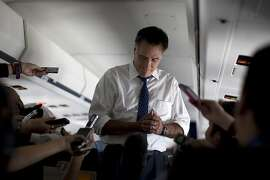 Republican presidential candidate, former Massachusetts Gov. Mitt Romney pauses as he speaks with the media aboard his campaign plane during a flight to Boston, Friday, Sept. 28, 2012.  (AP Photo/ Evan Vucci)