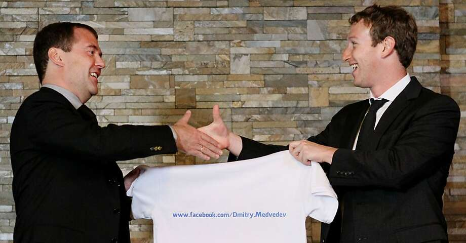 Russia's Prime Minister Dmitry Medvedev receives a T-shirt from Facebook CEO Mark Zuckerberg. Photo: Yekaterina Shtukina, AFP/Getty Images