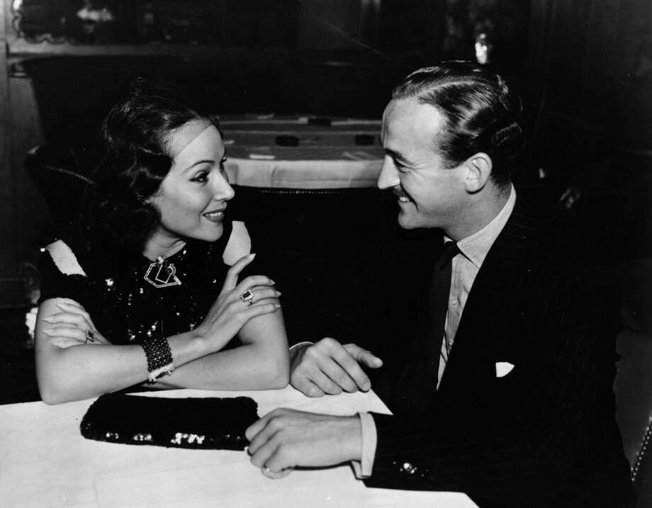 1958: Co-host David Niven, who hosted the awards three times, is pictured above with  Dolores Del Rio. Photo: Hulton Archive, Getty Images / Hulton Archive