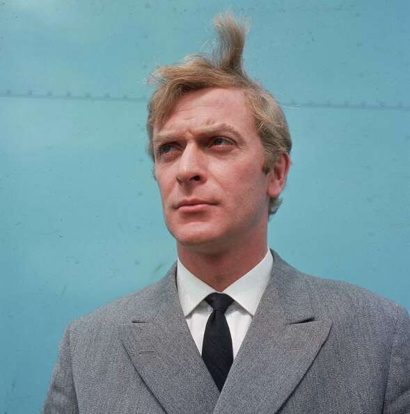 1973: Co-host Michael Caine