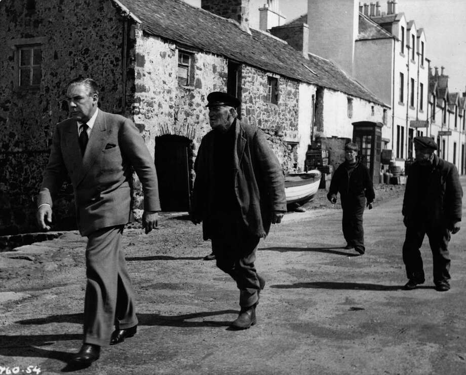 1950: Paul Douglas, left, pictured with Alex Mackenzie, Abe Barker and Tommy Kearins. Photo: Robert Penn, Getty Images / Hulton Archive