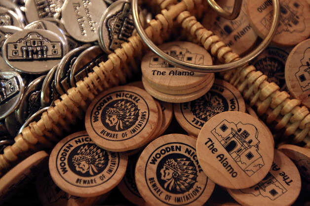 Wooden nickels for sale at the Alamo gift shop, Monday, Oct. 1, 2012. Event Network, which manages gift shops at several historical sites nationally, has taken over the Alamo gift shop starting Monday. The General Land Office hired the firm. GLO took over the management of the Alamo from the Daughters of the Republic of Texas. The couple is from Dallas Photo: Jerry Lara, San Antonio Express-News / © 2012 San Antonio Express-News