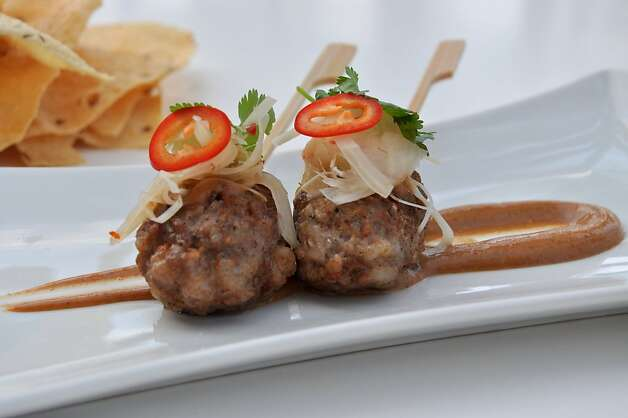 European and Asian influences come together in chef Alan Wong's skewered lamb and pork sausage with hoisin five-spice Greek yogurt, served at Amasia in the Grand Wailea on Maui. The Obamas are fans of his restaurant in Honolulu, and Wong also has a more moderately priced restaurant in the Ala Moana Shopping Center. Photo: Amasia