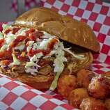 """The """"Hog Heaven"""" Pulled Pork sandwich with Sweet Potato Tots at Best Lil' Pork House in San Rafael."""