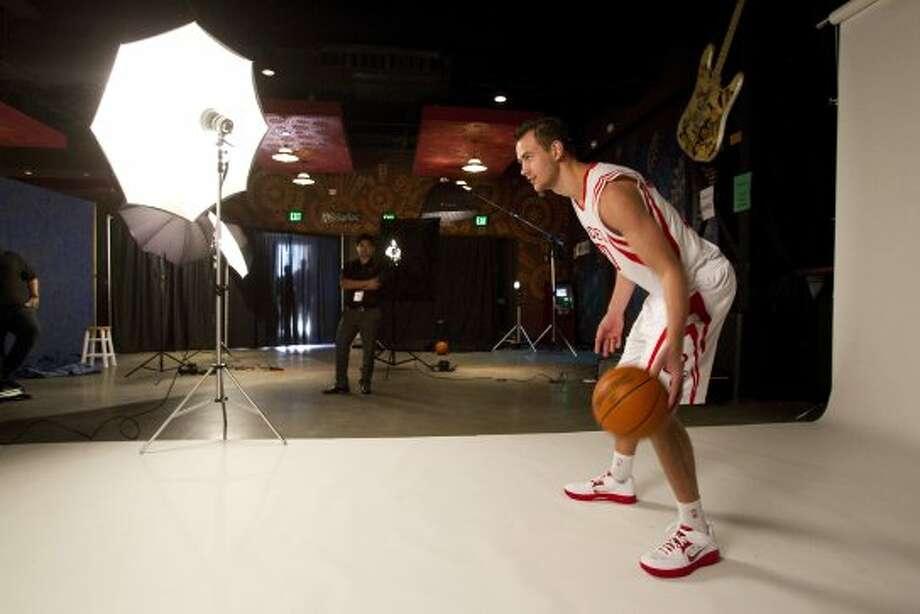 Rockets forward Donatas Motiejunas poses for portraits. (Brett Coomer / © 2012 Houston Chronicle)