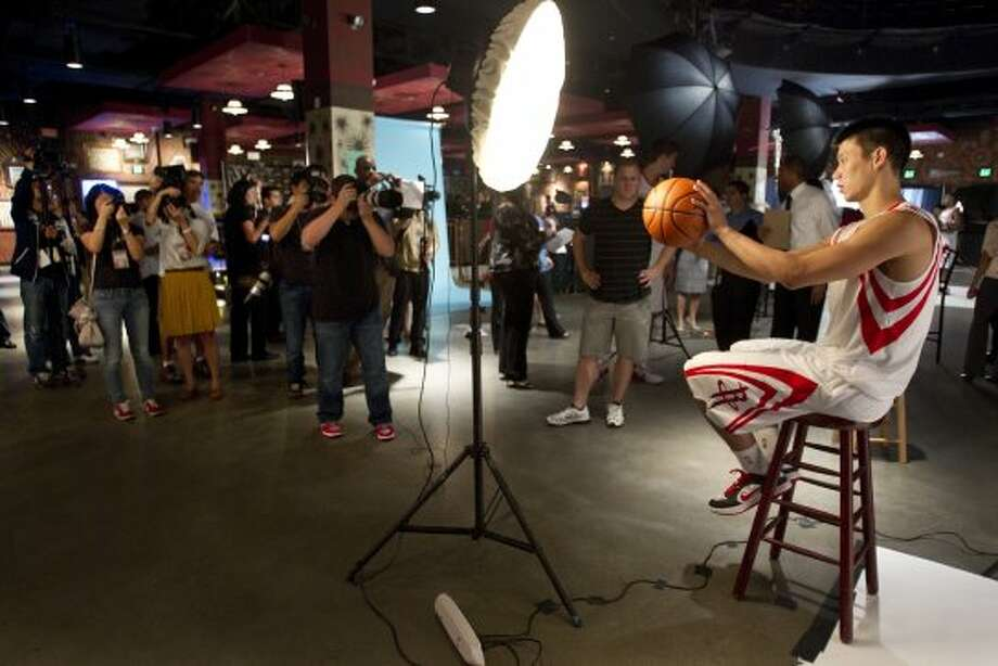Rockets guard Jeremy Lin was never far from a throng of reporters and photographers on Rockets Media Day. (Brett Coomer / © 2012 Houston Chronicle)