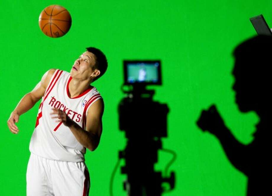 Rockets guard Jeremy Lin flips a ball in the air while filming a video promo. (Brett Coomer / © 2012 Houston Chronicle)