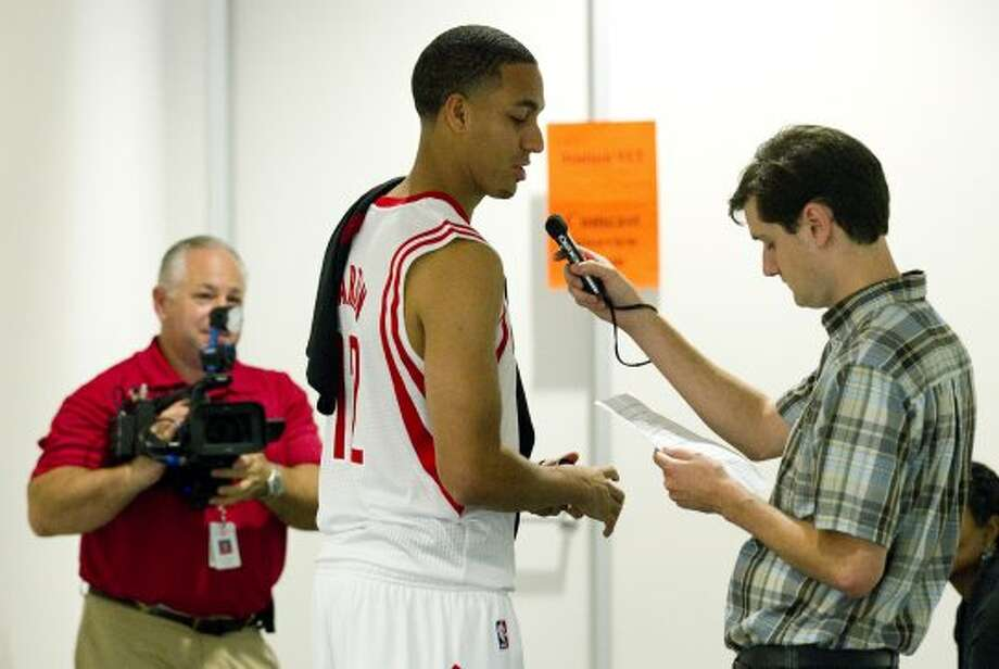 Rockets guard Kevin Martin, center, tapes a radio promotion during Rockets Media Day. (Brett Coomer / © 2012 Houston Chronicle)