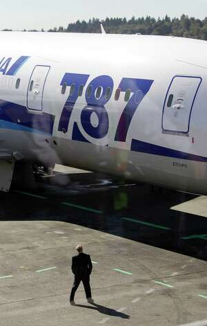 A Boeing 787 operated by All Nippon Airways is shown parked at a gate at Seattle-Tacoma International Airport, Monday, Oct. 1, 2012, on the first day of service for the 787 on ANA's Seattle-Tokyo route. Photo: Ted S. Warren, AP / AP