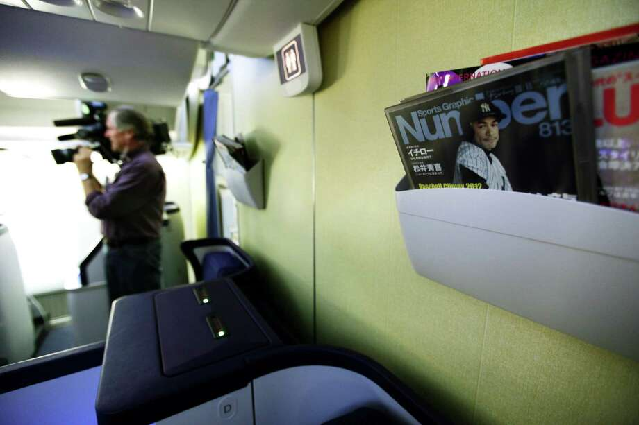 A Japanese sports magazine featuring Ichiro Suzuki in a New York Yankees uniform is shown in the international business class section of a Boeing 787 operated by All Nippon Airways, at Seattle-Tacoma International Airport, Monday, Oct. 1, 2012, on the first day of service for the 787 on ANA's Seattle-Tokyo route. After an official welcoming ceremony, the flight was delayed due to a maintenance issue. Photo: Ted S. Warren, AP / AP