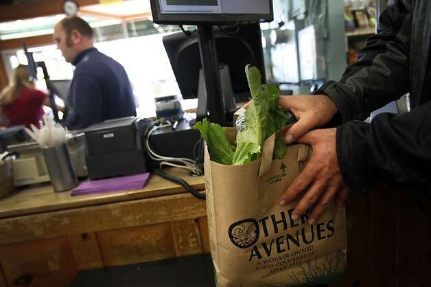A customer opts to pay the ten-cent charge to get a paper bag at Other Avenues in San Francisco, Calif., Monday, October 1, 2012.   San Francisco's city-wide plastic bag ban went into effect Monday, and now people will be charged for paper bags. Photo: Sarah Rice, Special To The Chronicle