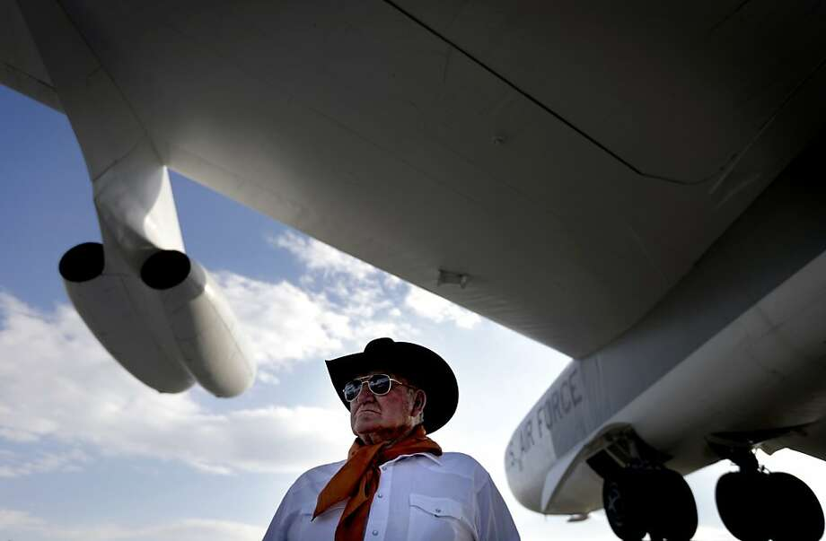 Cliff Andre of Denver, waits to enter a campaign event for Republican presidential candidate and former Massachusetts Gov. Mitt Romney at the Wings Over the Rockies Air and Space Museum, Monday, Oct. 1, 2012, in Denver. (AP Photo/David Goldman) Photo: David Goldman, Associated Press