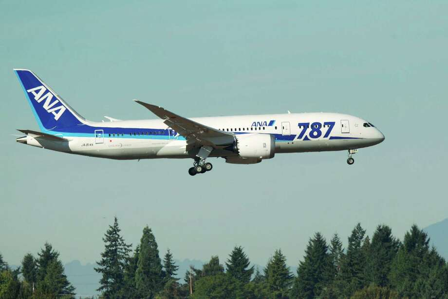 A Boeing 787 operated by All Nippon Airways comes in for a landing at Seattle-Tacoma International Airport, Monday, Oct. 1, 2012, on the first day of service for the 787 on ANA's Seattle-Tokyo route. Photo: Ted S. Warren / Associated Press