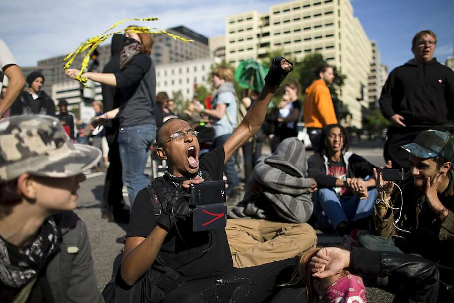 Occupy DC participants block Pennsylvania Avenue in Washington, Monday, Oct. 1, 2012, during a demonstration to mark the one-year anniversary of the Occupy protests.  (AP Photo/ Evan Vucci) Photo: Evan Vucci, Associated Press