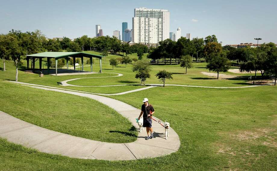 Spotts Parkis one of Houston's hillier parks with trails, playgrounds and tennis, volleyball and basketball courts.Find it at 401 S. Heights. Photo: Nick De La Torre, Houston Chronicle / © 2012  Houston Chronicle