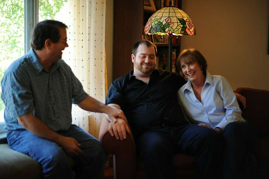 Anne La Londe-Berg, sitting with son Patrick (center) and husband Gerry, is pleased the drug doesn't cause hair loss. Photo: Erik Castro, Special To The Chronicle
