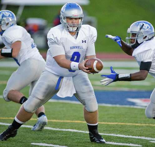 Bunnell High School quarterback Bryan Castelot hands off the ball during a football game at New Fairfield High School. Monday, Oct. 1, 2012 Photo: Scott Mullin