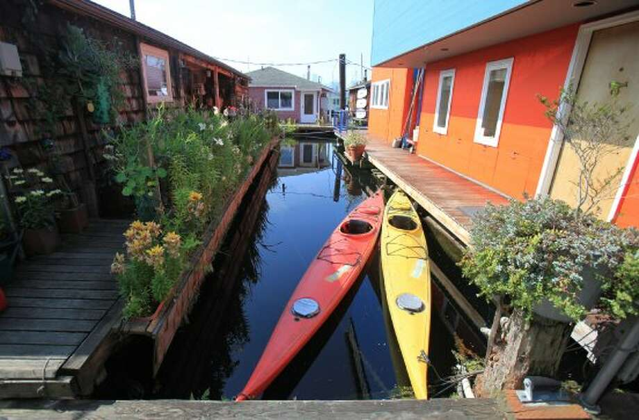 "Seattle's houseboat community is colorful and eclectic. Legal houseboats, shown here, are technically called ""floating homes."" A landlubber's primer: Floating homes are often called houseboats, but not all houseboats can be called floating homes. House barges, vessels and illegal houseboats are not considered floating homes according to city code, and are regulated differently. (Joshua Trujillo / seattlepi.com)"