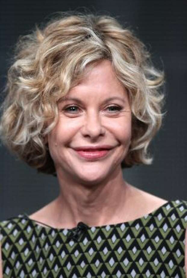 Actress Meg Ryan and her iconic hair are 51.