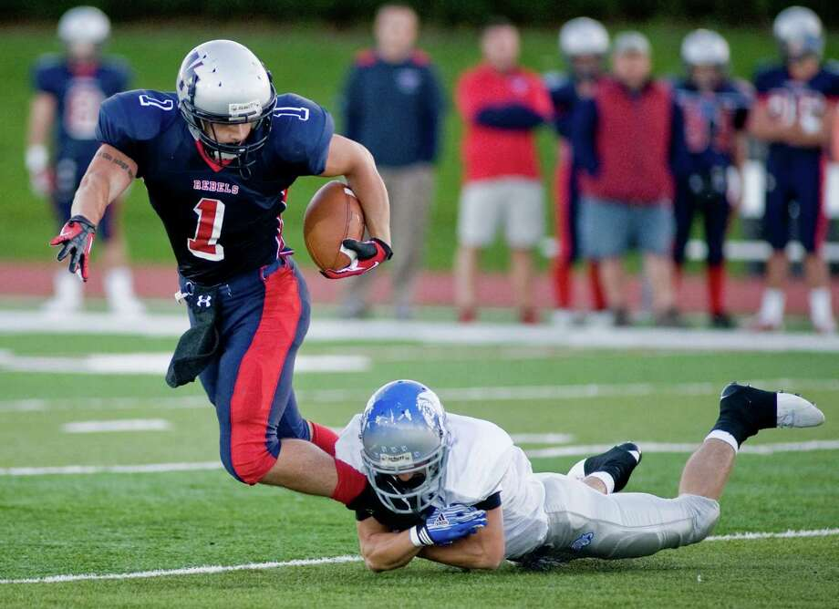 New Fairfield High School's Joe Pacheco is caught by Bunnell High School's Ian Taylor during a football game at New Fairfield High School. Monday, Oct. 1, 2012 Photo: Scott Mullin