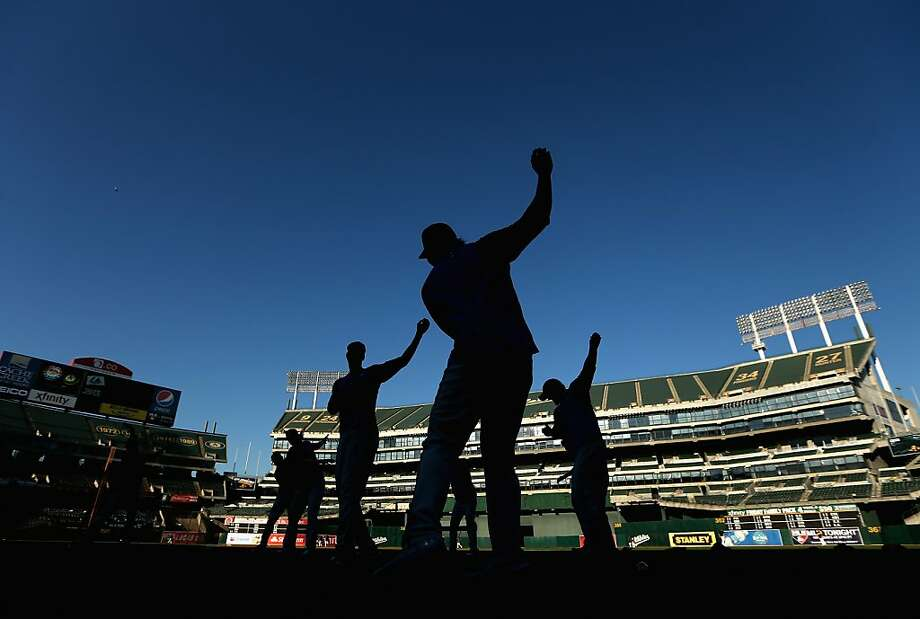 OAKLAND, CA - OCTOBER 01: Players for the Texas Rangers stretch before their game against the Oakland Athletics at O.co Coliseum on October 1, 2012 in Oakland, California.  (Photo by Ezra Shaw/Getty Images) Photo: Ezra Shaw, Getty Images