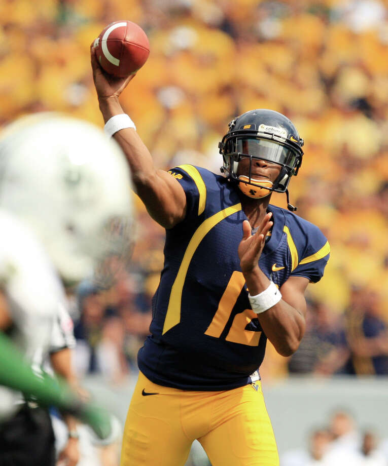 West Virginia quarterback Geno Smith will test UT's defense after throwing for eight scores last week. Photo: Christopher Jackson / FRE170573 AP