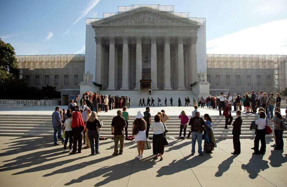 People wait in line to enter the Supreme Court in Washington, Monday, Oct. 1, 2012. The Supreme Court is embarking on a new term that could be as consequential as the last one with the prospect for major rulings about affirmative action, gay marriage and voting rights. (AP Photo/Carolyn Kaster) Photo: Carolyn Kaster