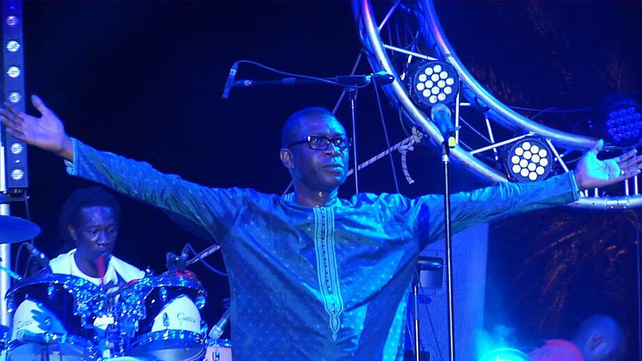 Activist, singer and percussionist Youssou N'Dour performs at a concert after Senegalese elections in a segment of the series. Photo: KQED